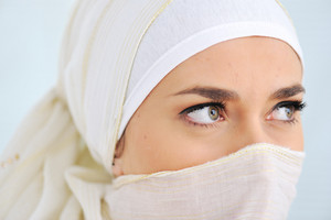 Muslim beautiful woman with scarf and veil, closeup