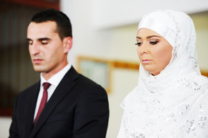 Muslim bride and groom at the mosque during a wedding ceremony
