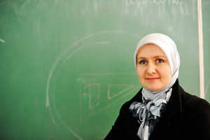 Muslim female teacher at school