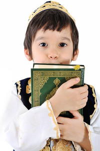 Muslim kid with holy Quran