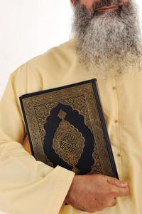 Muslim man, long beard, Koran in hand
