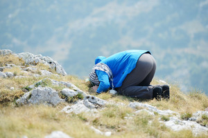 Muslim man praying in pure nature