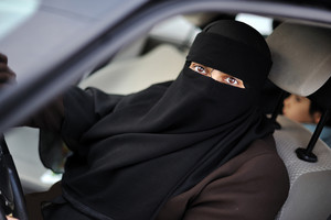 Muslim middle eastern female driver wearing veil