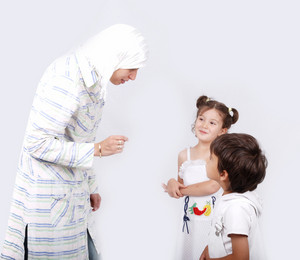 Muslim mother and her children