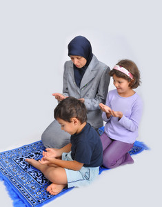 Muslim mother with children learning them