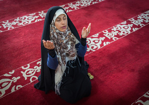 Muslim woman praying inside the mosque