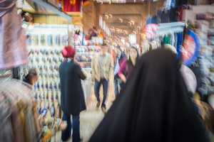 Muslim woman walking in blur motion on the street