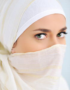 Muslim woman with veil looking at camera