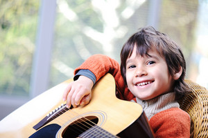 My son playing guitar at home