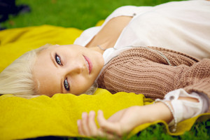 Natural young woman relaxing in park