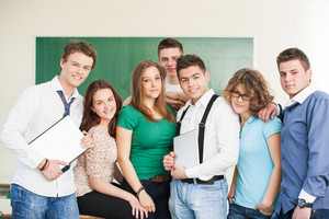 Neatly dressed group of seven students in a classroom