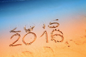 New Year 2016 replace 2015 concept writing sand on the sea beach