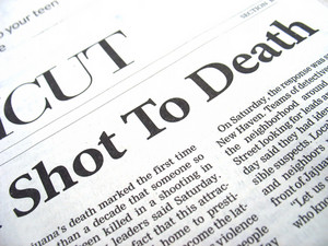 newspaper headline: shot to death