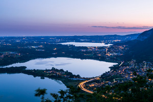 Night view of the city Lecco and Lake Garlate, Alps, Italy.
