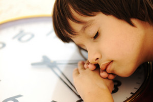 Now is the time for the school?! Kid sleeping on the clock