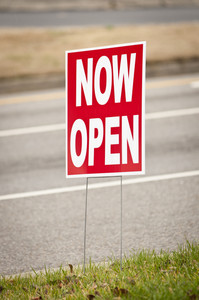 NOW OPEN Sign By Roadway