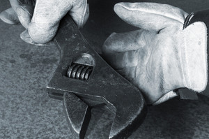 nuts and bolts, wrench and gloves