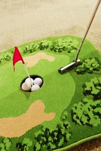 Office golf - golf ball and putter