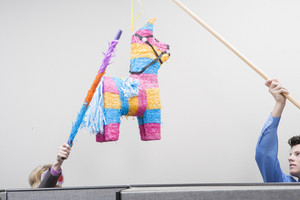 Office people celebrating with pinata