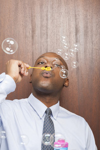 Office person blowing bubbles