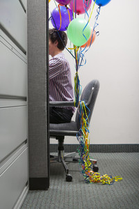 Office person sitting with ballons