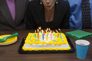 Office person with birthday cake