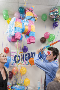 Office person with pinata