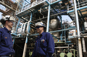 oil and gas engineers inside refinery