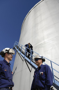 oil and gas engineers with fuel tanks