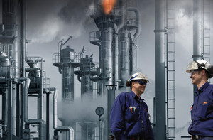 oil and gas workers with chemical flame and industry