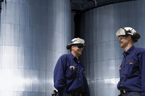 oil and gas workers with fuel storage
