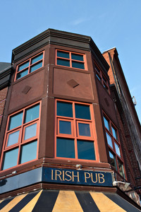 Old building with a sign on front that reads Irish Pub.