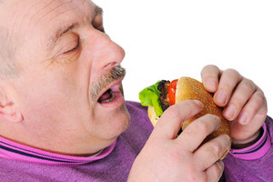 Old man with moustache eating burger