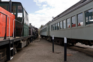 Old train cars lined up in the railroad yard awaiting passengers.