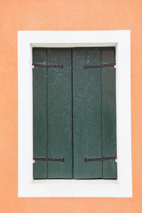 Old vintage wood door with old green wallpaper