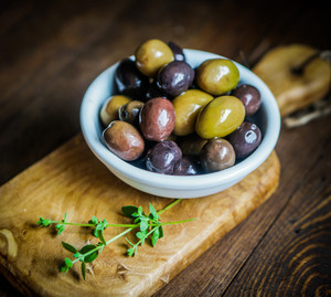 Olives On Rustic Wooden Background