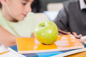 One apple on books