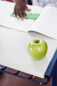 One red apple on desk