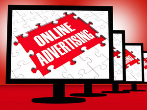 Online Advertising On Monitors Showing Marketing Strategies