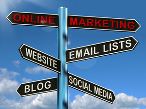 Online Marketing Signpost Showing Blogs Websites Social Media And Email Lists