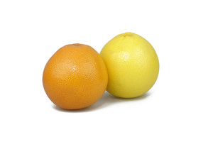 Orange And Grapefruit On White Background