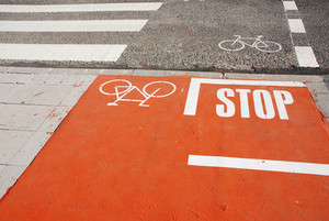 Orange Bicycle Lane With A Stop Sign