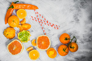 Orange Fruits And Vegetables On Rustic Background
