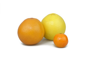 Orange, Grapfruit And Mandarin On White Background