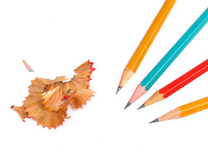 Orange, Green And Red Pencils And Cuttings Isolated On White