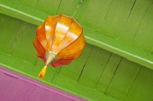 Orange lantern on green ceiling