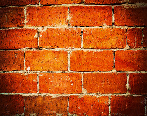 Orange wall tiles background