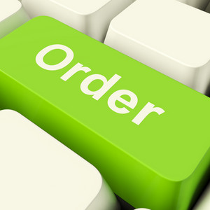 Order Computer Key In Green Showing Online Purchasing And Shopping