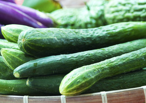Organic Cucumbers Being Sold In A Market
