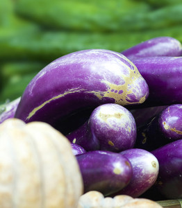 Organic Eggplants And Pumpkins In A Market